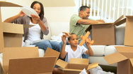 Ethnic Family Unpacking After House Move Stock Footage