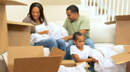 Ethnic Family Fun with Packing Paper Stock Footage