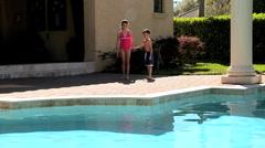 Caucasian Siblings Enjoying the Swimming Pool Stock Footage