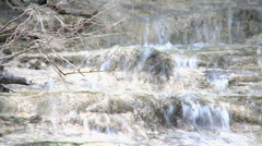 Waterfall on eroded limestone rock during wintertime Stock Footage