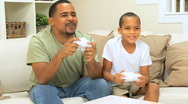Ethnic Father & Son Playing Games Stock Footage