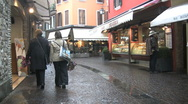 Italy Sirmione street with shoppers Stock Footage