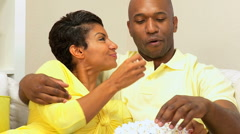 African-American Couple at Home Eating Popcorn Stock Footage