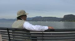 Italy Veneto Bardolino man by lake Stock Footage