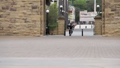 Cyclist at University Stock Footage