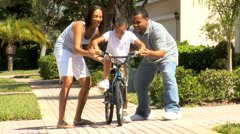 Young Ethnic Boy Practicing Bicycle Riding Stock Footage