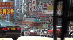 Cyclist and bus in character street Kowloon Stock Footage