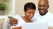Loving Couple Using Laptop at Home Stock Footage