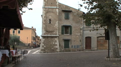 Tilts up a church tower in Bardolino Italy Stock Footage