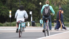 Students riding bicycles Stock Footage