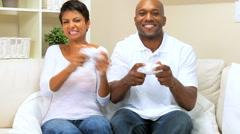 Ethnic Couple Playing on Games Console Stock Footage