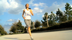 Caucasian Girl Jogging Outdoors - stock footage