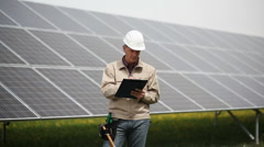Technician at solar power station Stock Footage