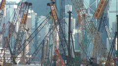 Cranes before Hong Kong skyline, industry, construction, building site, China Stock Footage
