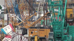 Cranes in central Hong Kong, construction site Stock Footage