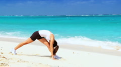 Attractive Female Exercising on the Beach Stock Footage