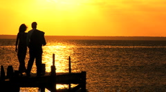 Elegant Couple on Jetty at Sunset Stock Footage