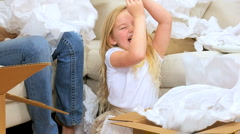 Family Females Playing with  Tissue from Moving Cartons Stock Footage