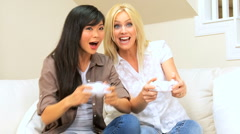 Multi-Ethnic Female Friends Playing Electronic Games - stock footage