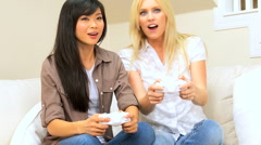 Girlfriends Playing Electronic Games Stock Footage