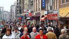 Damrak, Amsterdam city central street, Holland Stock Footage
