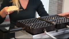Woman makes Belgian Waffle Stock Footage