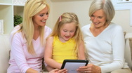 Stock Video Footage of Three Generations of Females with Wireless Tablet