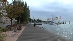Italy Veneto Bardolino walk by lake Stock Footage