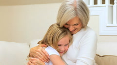 Cute Little Girl Being Hugged by Grandma Stock Footage