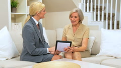 Future Planning for Senior Client With Wireless Tablet Stock Footage