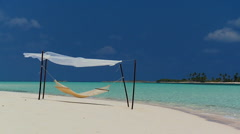 Hammock Swaying Over Tropical Beach - stock footage