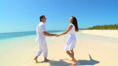 Attractive Couple Laughing & Dancing on Luxury Island Vacation Stock Footage
