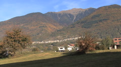 Italy Lombardy town on a hillside above a valley Stock Footage