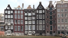 Amsterdam Holland streets, canals, bridges, buildings, boats Stock Footage