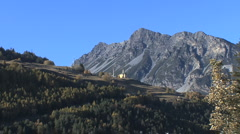 Italy Lombardy Alps church on hill Stock Footage