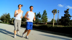 Healthy Couple Jogging Exercise Stock Footage