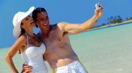 Stock Video Footage of Beach Vacation Couple with Camera