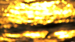 Sunlight on Ripples of Water in Blurred Motion Stock Footage