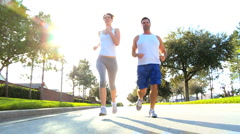Attractive Couple Jogging to Keep Fit - stock footage