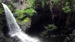 Tropical Waterfall and Cave Stock Footage