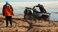 Quad bike drive out from the mud Stock Footage