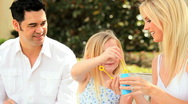 Multi-Ethnic Family Fun Blowing Soap Bubbles Stock Footage