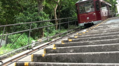 Tourist tram in Hong Kong going down Stock Footage