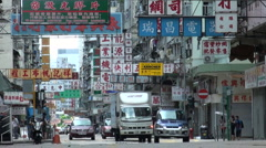 Traffic in Kowloon, characters on billboard, colorful, typical Hong Kong Stock Footage