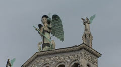 Statue of St Michael on a Lucca church Stock Footage