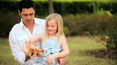 Little Blonde Girl with Asian Father in Park Stock Footage