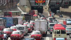 China Hong Kong massive traffic jam cars congestion tunnel entry Stock Footage