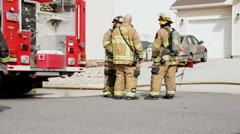 Firefighters and fire trucks HD3916 - stock footage