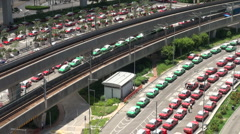 Train arrives at Hong Kong airport while taxis wait for customers Stock Footage