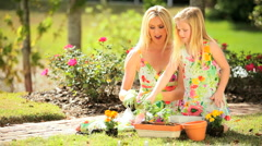 Pretty Blonde Mother & Daughter Gardening Together Stock Footage